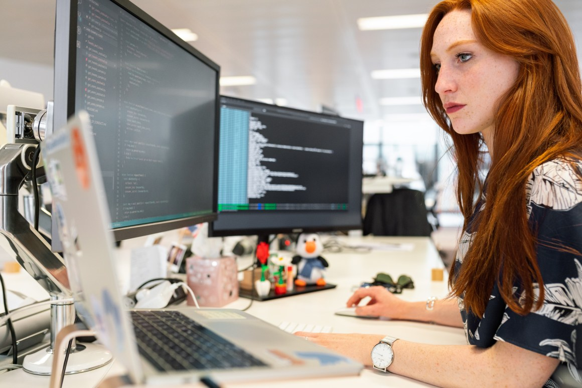 Woman coding on computer - Agile Process in Software Engineering