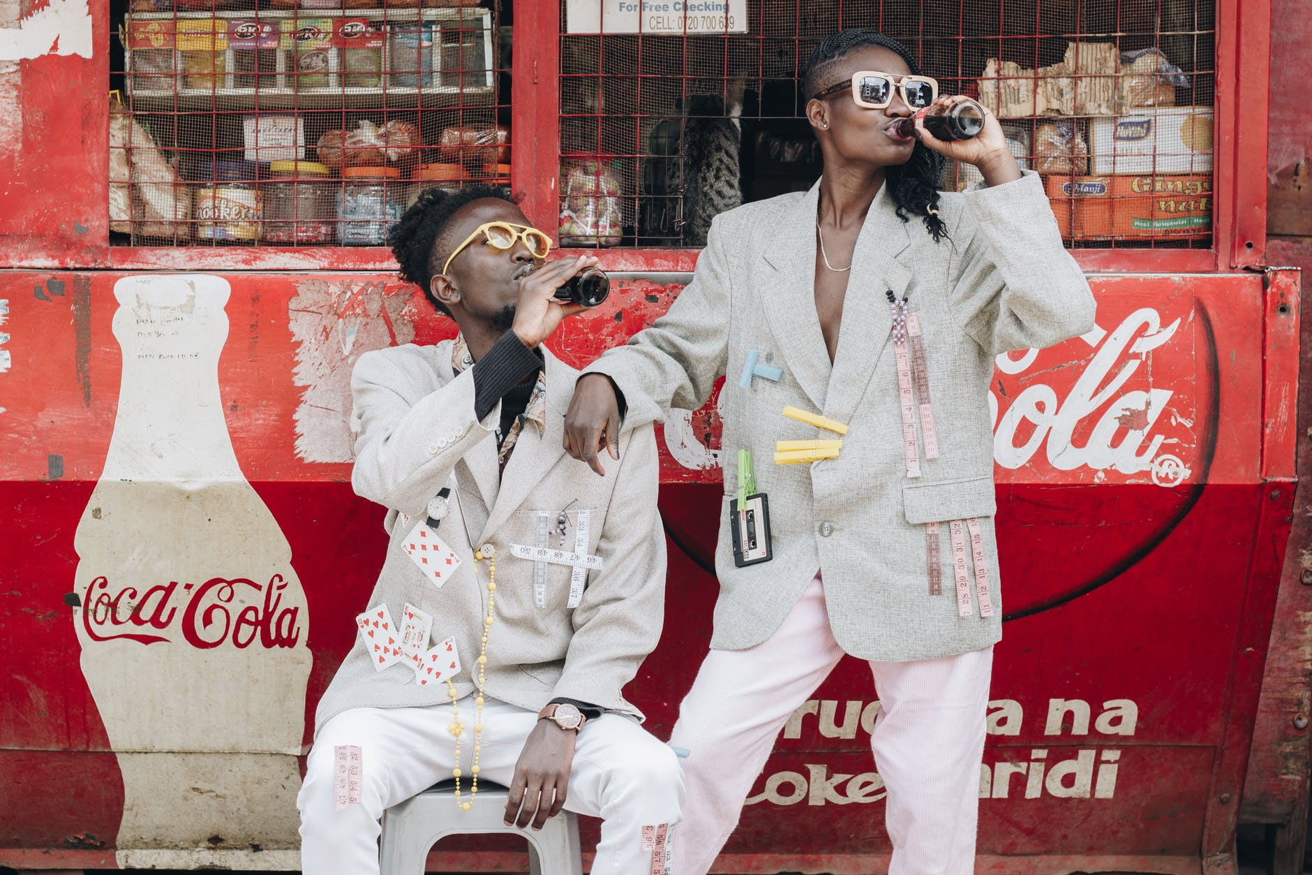 two person drinking coca cola next to a kiosk - How to Dominate Your Niche