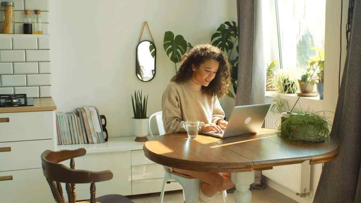 A women working on laptop for her small business. Article: How CRM can help your small business in 2021?