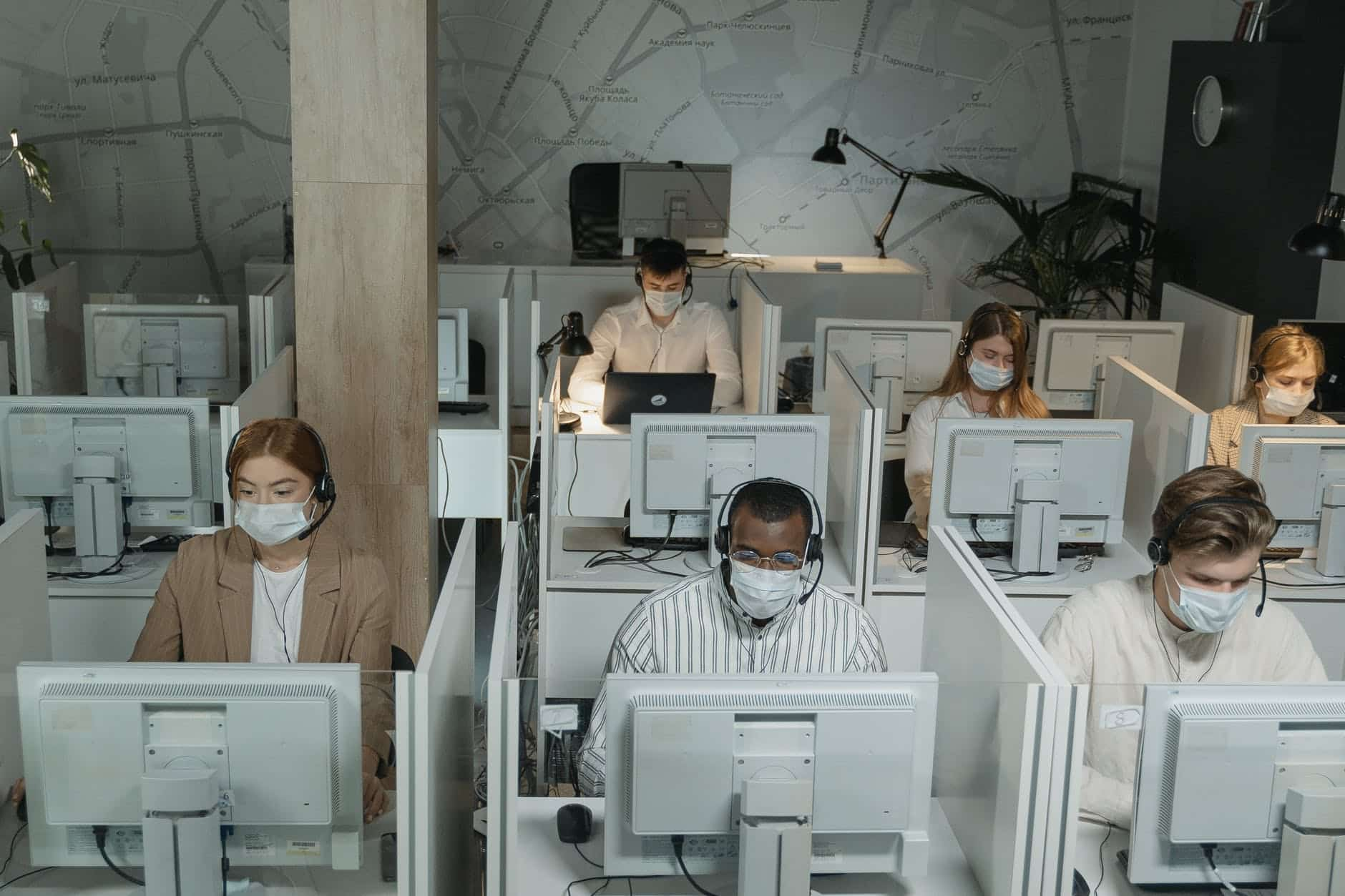People working in a call center, live chat software