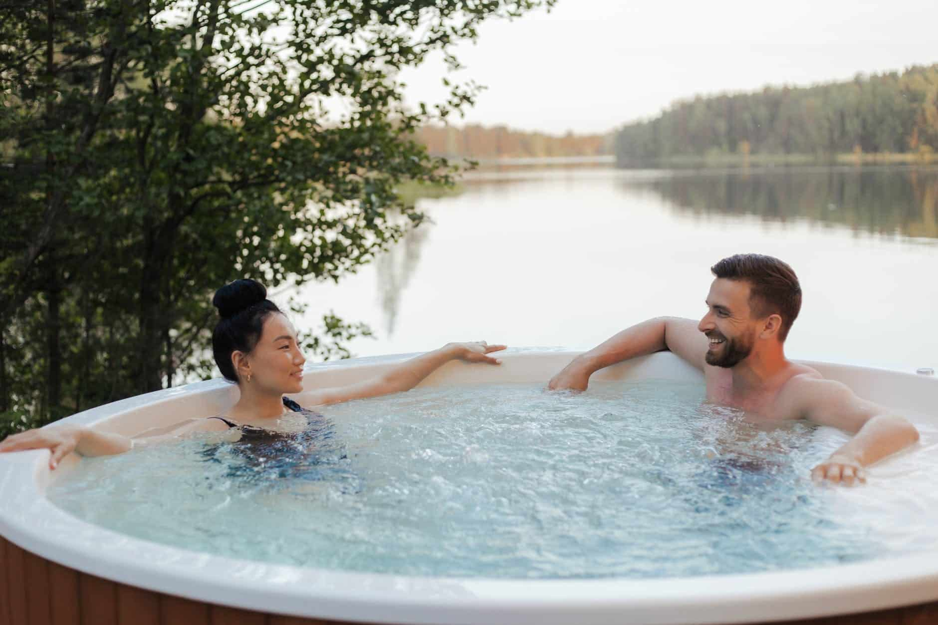 Couple looking at each other while relaxing in a jacuzzi